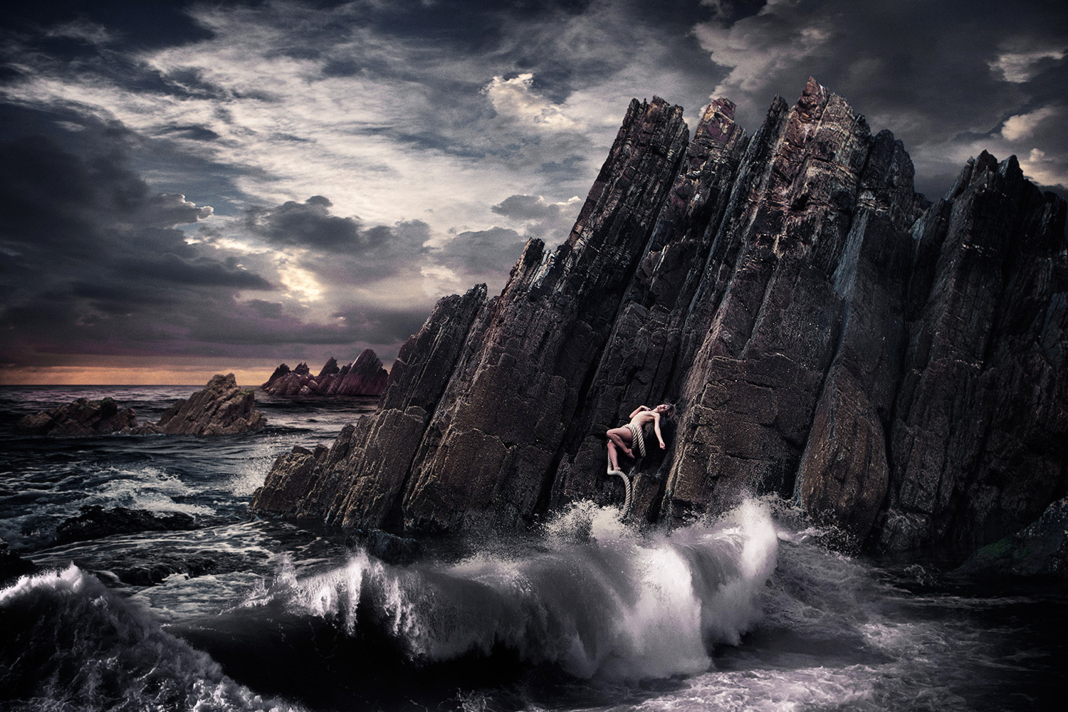 Raphaella on Welsh Rocks cast out to sea in theatrical image.